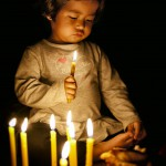 Little girl  exploring candles